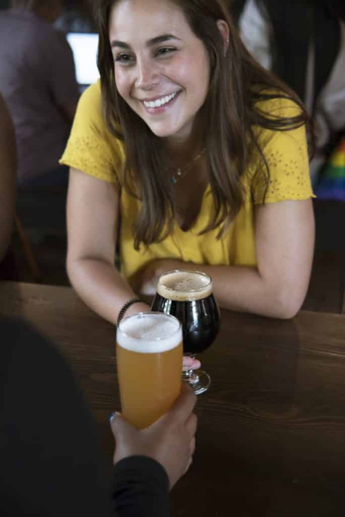 smiling woman drinking beer
