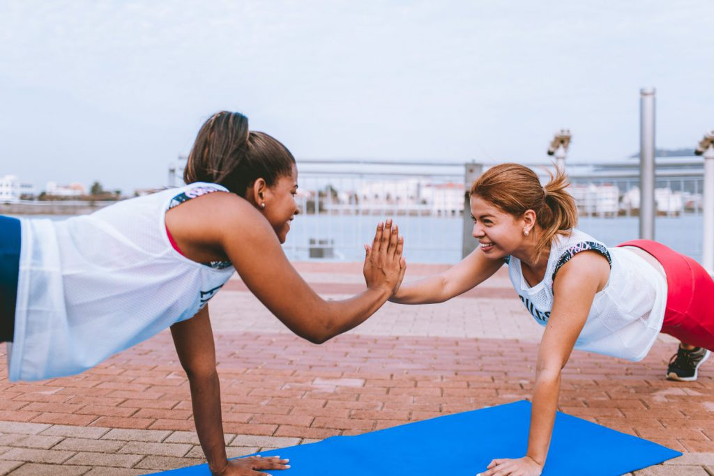 Girls exercising high-five each other