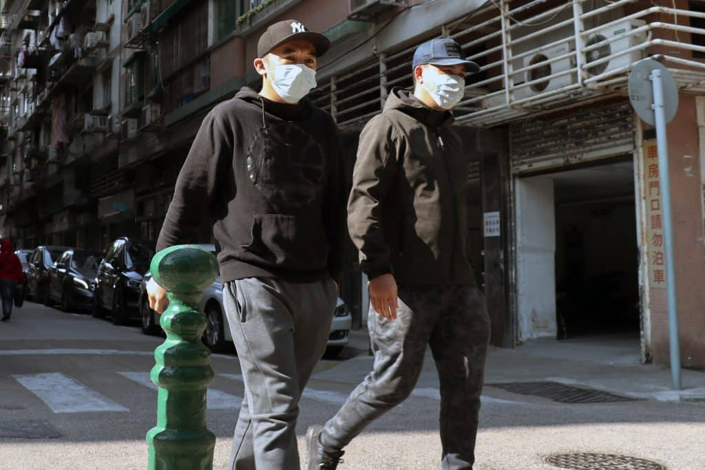 Men wearing masks in Macau during Coronavirus